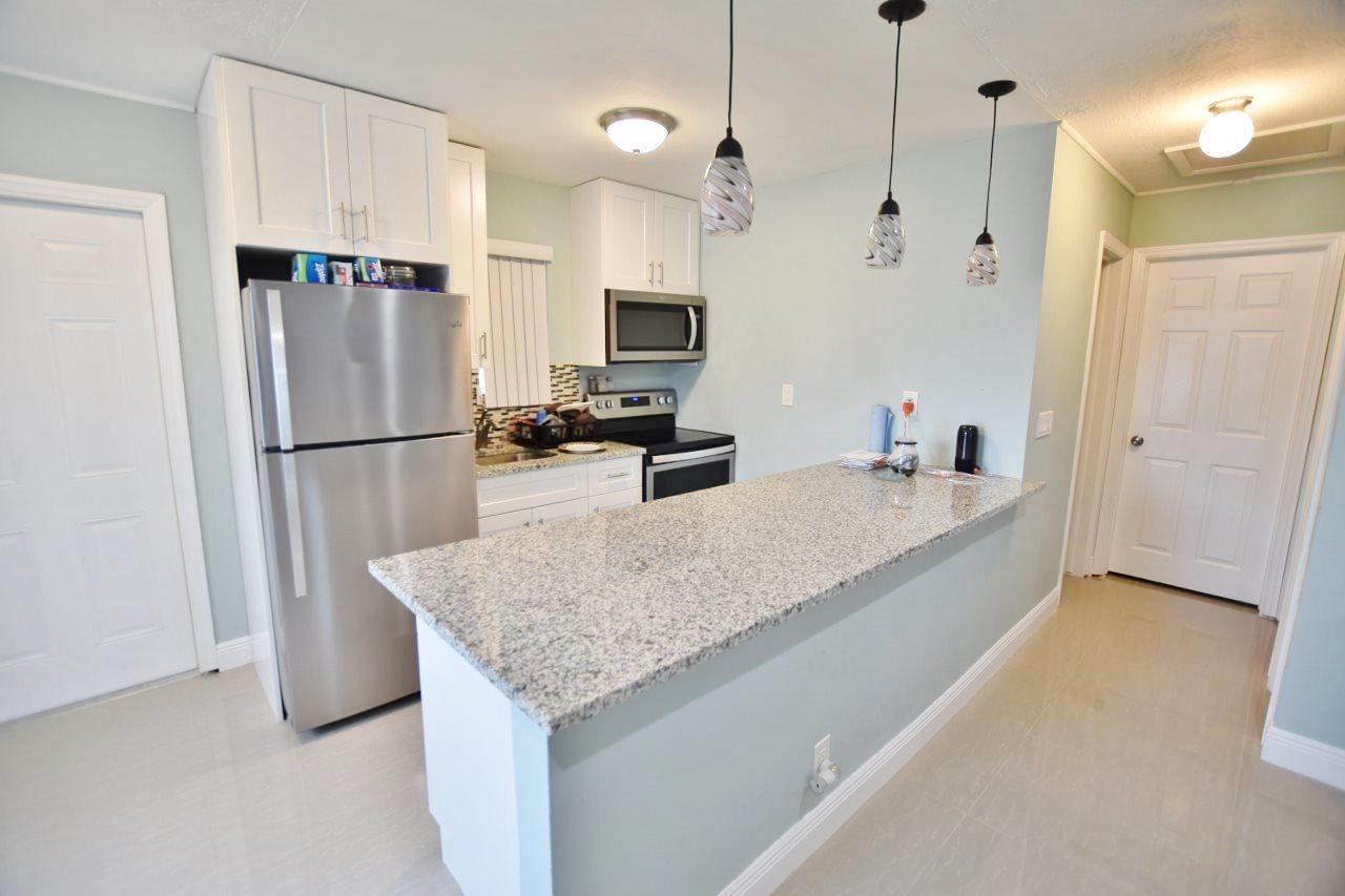 Photo of 1140 W 3rd Street, Riviera Beach, FL 33404 (MLS # RX-10672092)