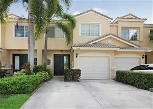 Photo of 5906 NW 47th Terrace, Coconut Creek, FL 33073 (MLS # RX-10537093)
