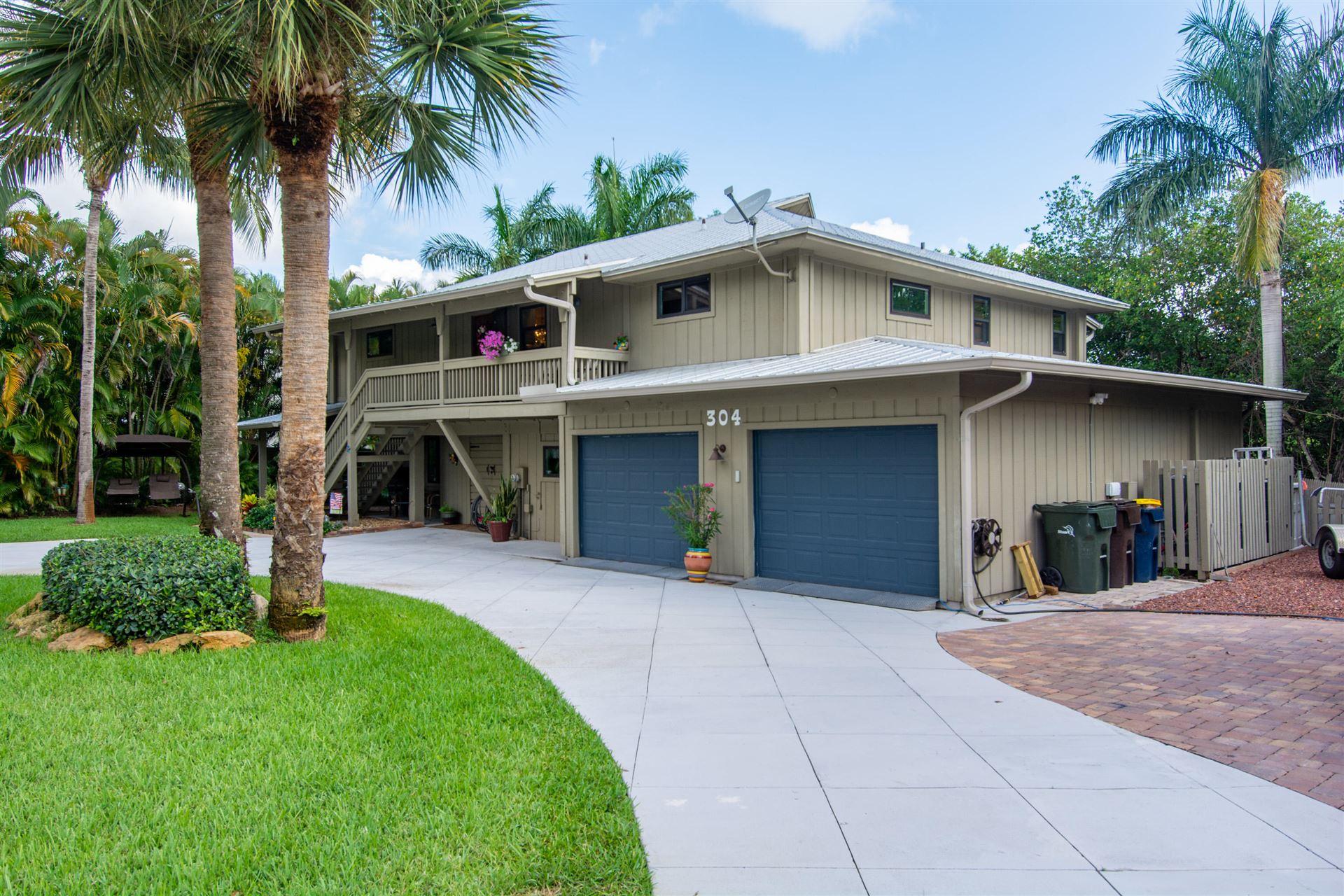 Photo of 304 SW Indian Groves Drive, Stuart, FL 34994 (MLS # RX-10735096)