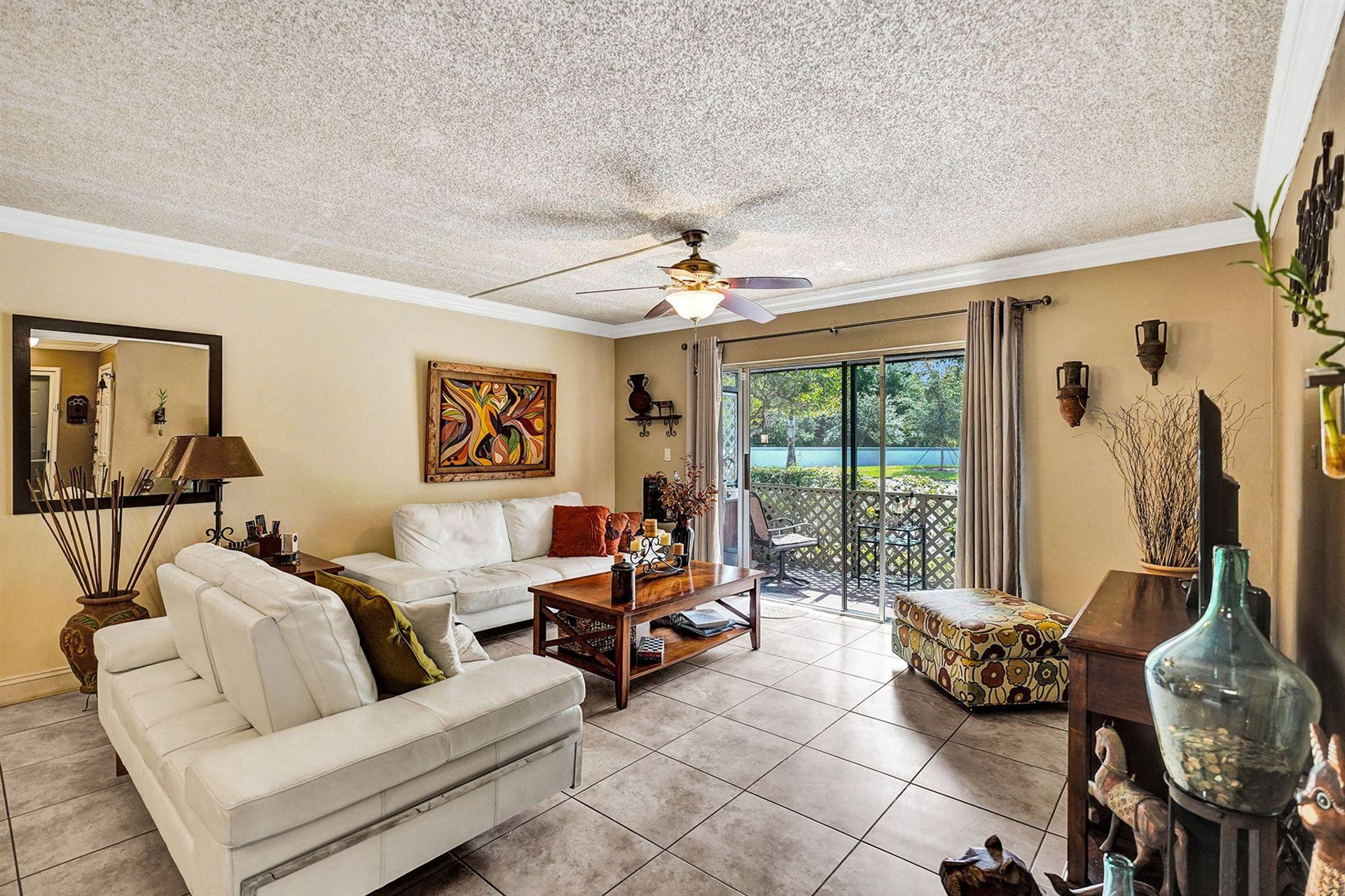 Photo of 2713 S Oakland Forest Drive #101, Oakland Park, FL 33309 (MLS # RX-10656097)