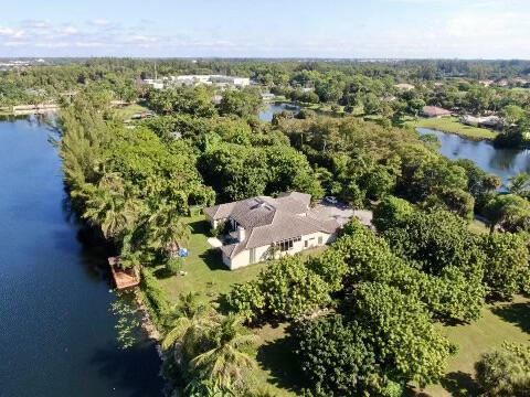 Photo of 8625 7th Place S, West Palm Beach, FL 33411 (MLS # RX-10754098)