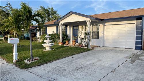 Photo of 1402 Richard Lane, Lake Worth, FL 33460 (MLS # RX-10707102)