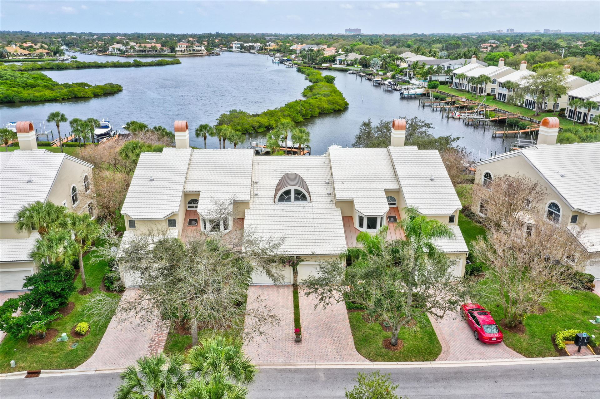 Photo of 214 Eagle Drive, Jupiter, FL 33477 (MLS # RX-10662110)