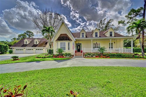 Photo of 6684 NW 67th Place, Parkland, FL 33067 (MLS # RX-10694112)