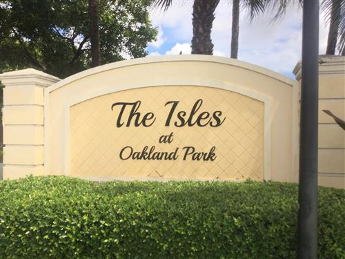 Photo of 3205 NW 32nd Terrace, Oakland Park, FL 33309 (MLS # RX-10653113)