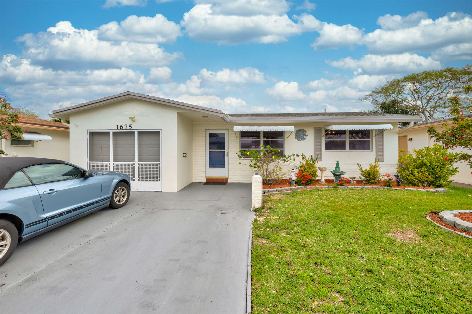 Photo of 1675 NW 69th Terrace, Margate, FL 33063 (MLS # RX-10695116)