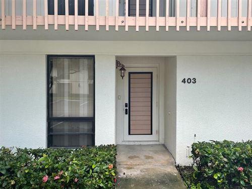 Photo of 403 Brackenwood Lane S, Palm Beach Gardens, FL 33418 (MLS # RX-10733117)