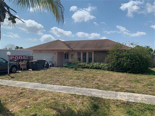 Photo of 2724 Flamango Lake Drive, West Palm Beach, FL 33406 (MLS # RX-10707119)