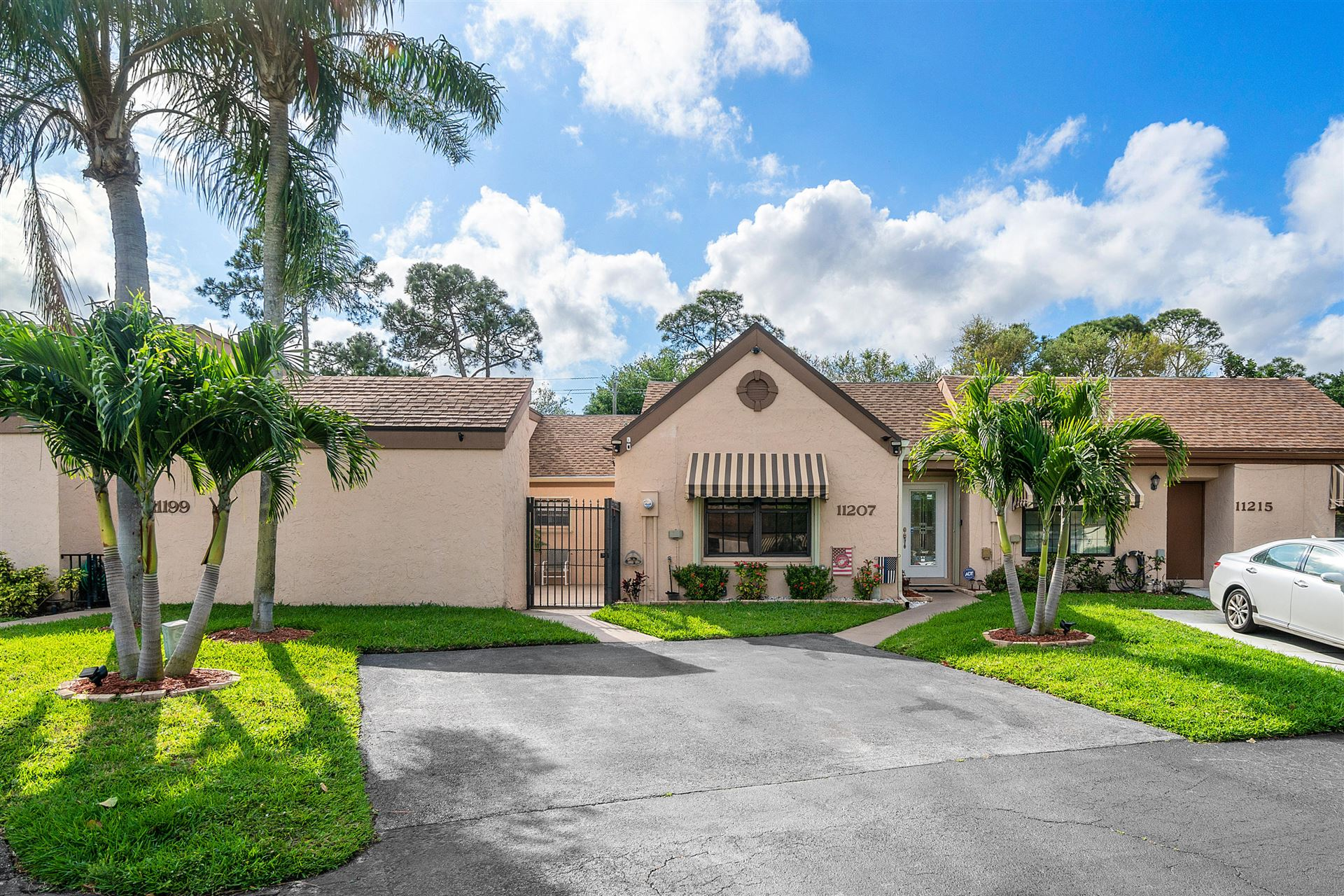 Photo of 11207 Curry Drive, Palm Beach Gardens, FL 33418 (MLS # RX-10700119)