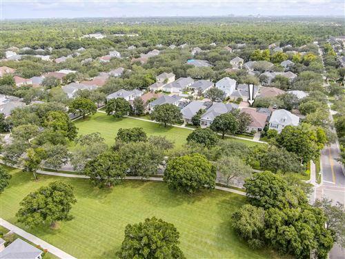 Photo of 114 Poinciana Drive, Jupiter, FL 33458 (MLS # RX-10747120)