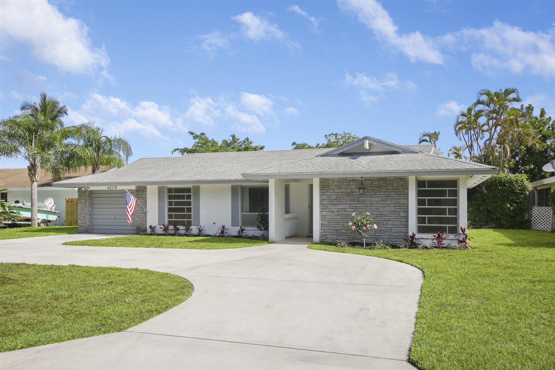 Photo of 4179 Hyacinth Circle N, Palm Beach Gardens, FL 33410 (MLS # RX-10716120)