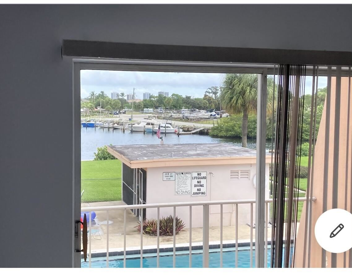 Photo of 725 Hummingbird Way #205, North Palm Beach, FL 33408 (MLS # RX-10731121)