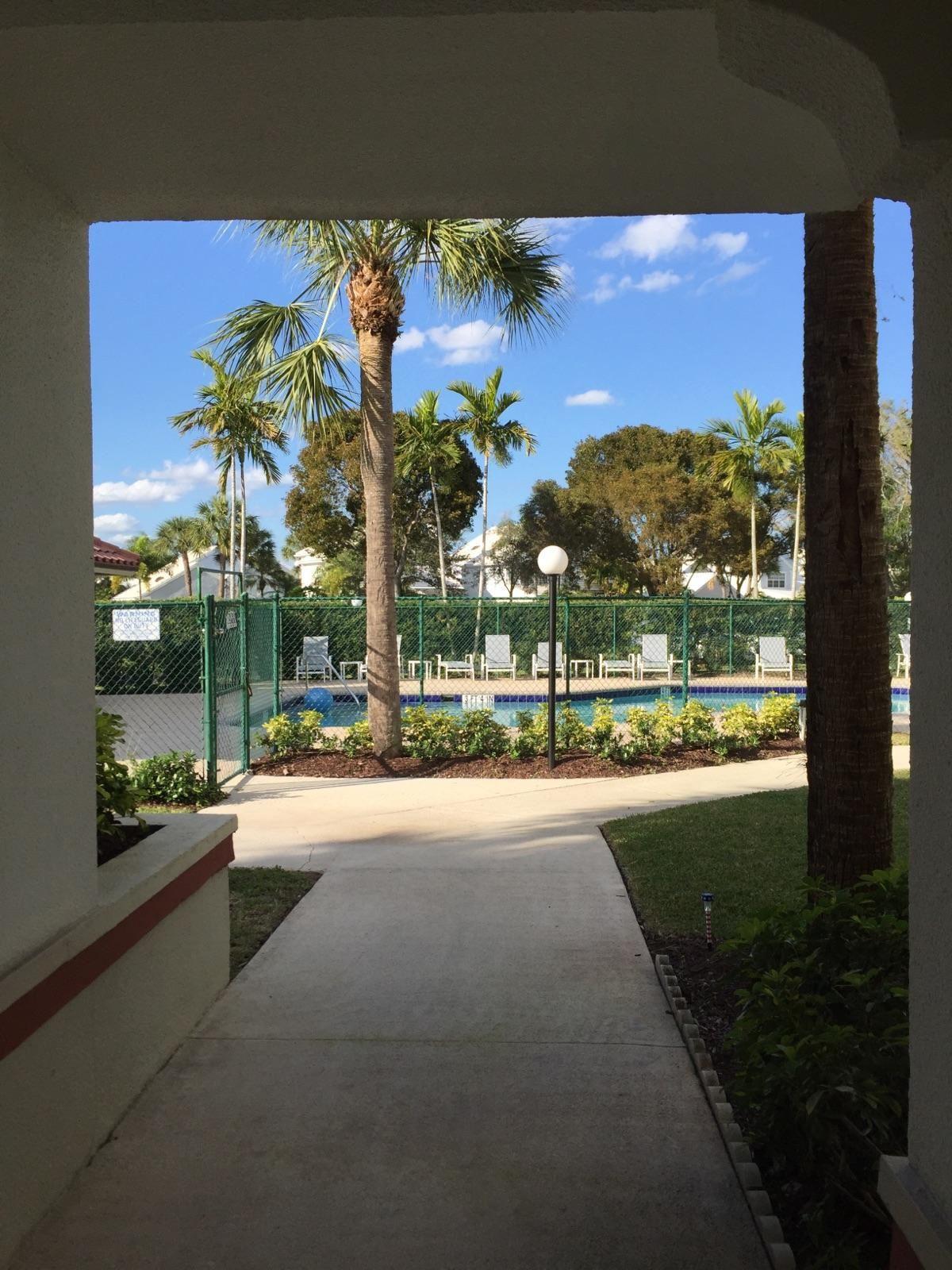 Photo of 116 Cypress Point Drive, Palm Beach Gardens, FL 33418 (MLS # RX-10620122)