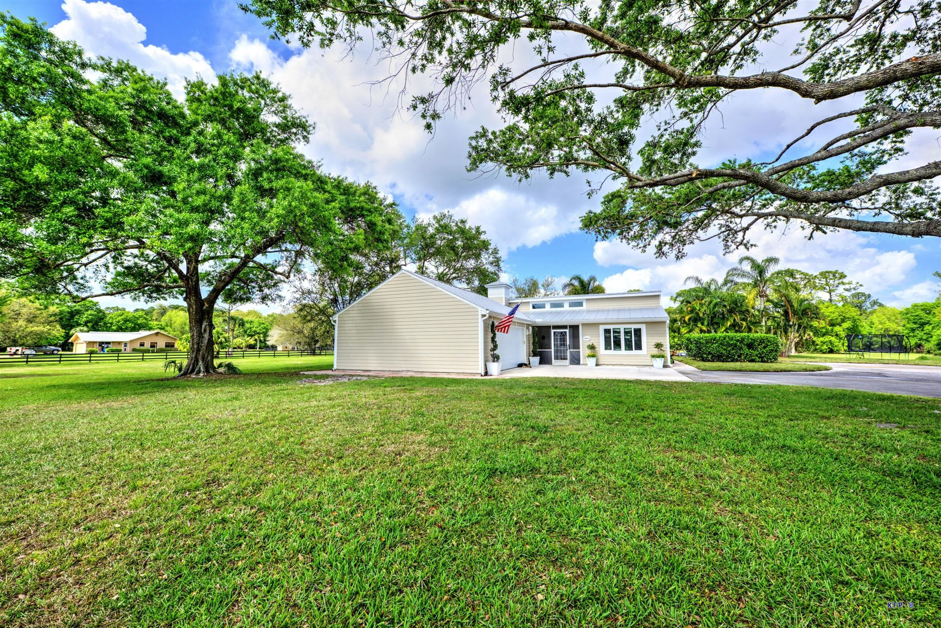 Photo of 5665 SW Woodham Street, Palm City, FL 34990 (MLS # RX-10697123)