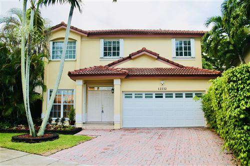 Photo of 12232 SW 143rd Lane, Miami, FL 33186 (MLS # RX-10746125)