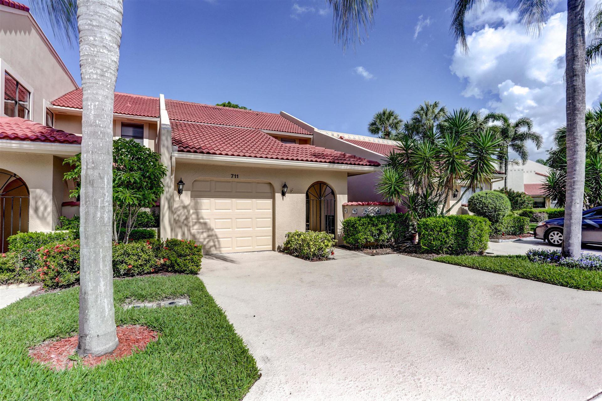 Photo of 711 Windermere Way, Palm Beach Gardens, FL 33418 (MLS # RX-10715126)