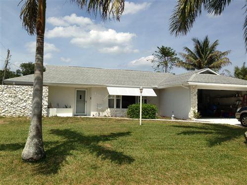 Photo of 1585 SE Portillo Road, Port Saint Lucie, FL 34953 (MLS # RX-10675129)