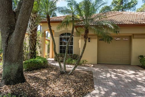 Photo of 1039 Via Jardin, Riviera Beach, FL 33418 (MLS # RX-10612139)