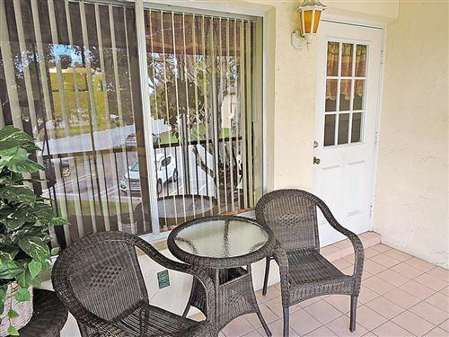 Photo of 3623 La Playas Court #D-2, Greenacres, FL 33463 (MLS # RX-10615139)