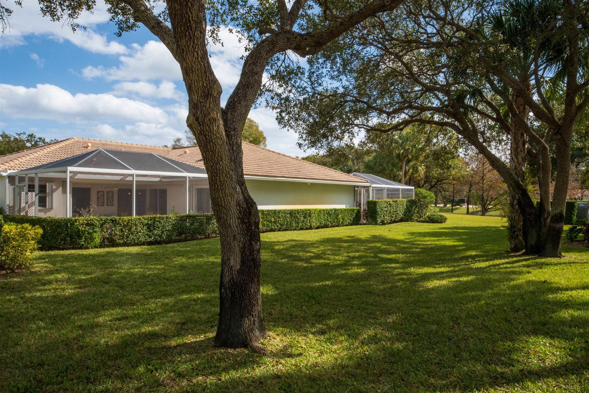 Photo of 701 Silverleaf Oak Court, Palm Beach Gardens, FL 33410 (MLS # RX-10683141)