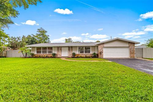 Photo of 641 Glenwood Lane, Plantation, FL 33317 (MLS # RX-10728143)