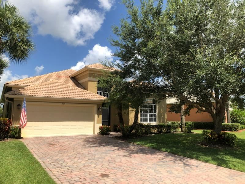 Photo of 302 NW Somerset Circle, Port Saint Lucie, FL 34983 (MLS # RX-10636146)