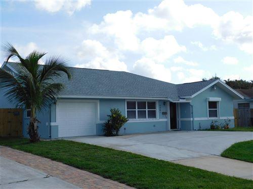 Photo of 4361 Fuschia Circle N, Palm Beach Gardens, FL 33410 (MLS # RX-10644150)