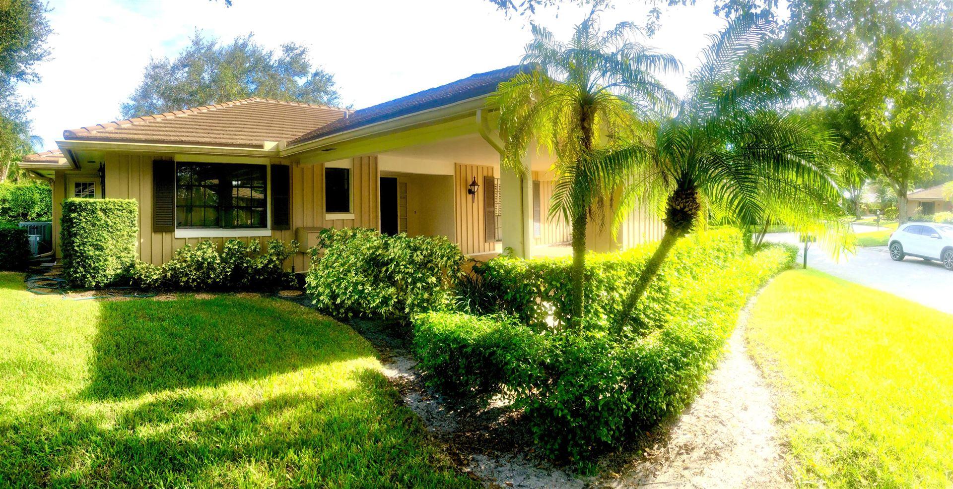 Photo of 712 Muirfield Circle, Atlantis, FL 33462 (MLS # RX-10676151)