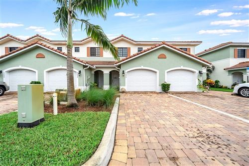 Photo of 4454 Leo Lane, Palm Beach Gardens, FL 33410 (MLS # RX-10670153)