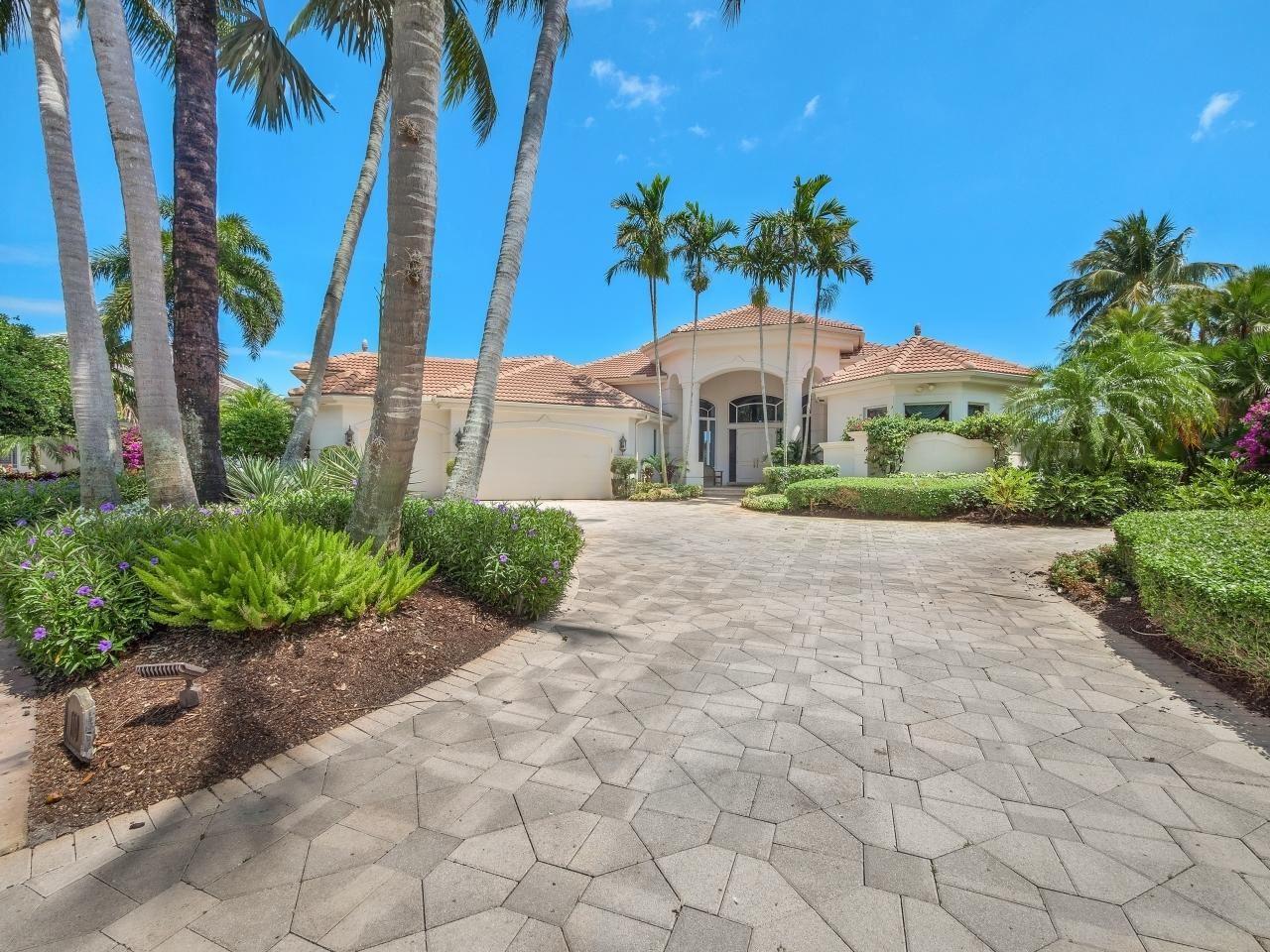 Photo of 110 Saint Edward Place, Palm Beach Gardens, FL 33418 (MLS # RX-10708153)