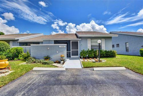 Photo of 4200 Lucerne Villas Lane, Lake Worth, FL 33467 (MLS # RX-10654154)