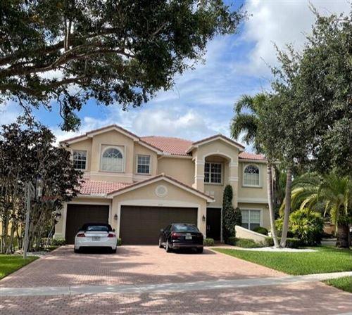 Photo of 9737 Napoli Woods Lane, Delray Beach, FL 33446 (MLS # RX-10722157)