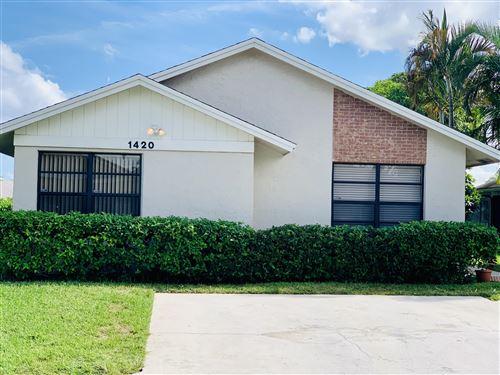 Photo of 1420 Longarzo Place, West Palm Beach, FL 33415 (MLS # RX-10754157)