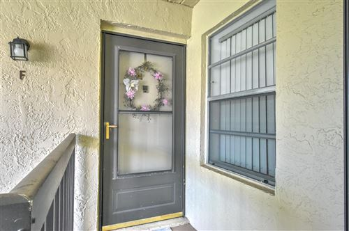 Photo of 6540 Chasewood Drive N #F, Jupiter, FL 33458 (MLS # RX-10753158)