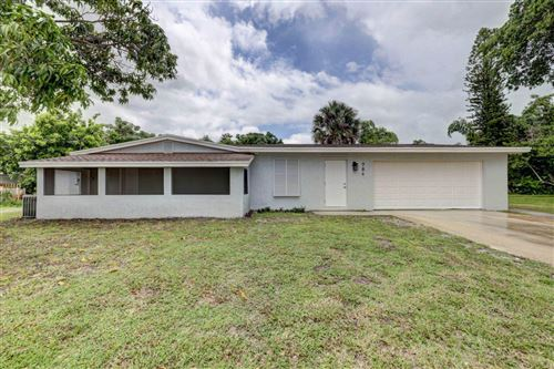 Photo of 786 NE Bernard Street, Jensen Beach, FL 34957 (MLS # RX-10632165)