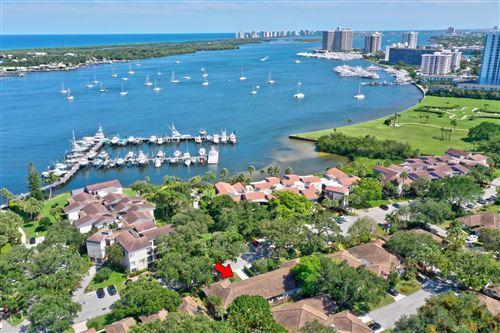 Photo of 11409 Twelve Oaks Way, North Palm Beach, FL 33408 (MLS # RX-10670166)
