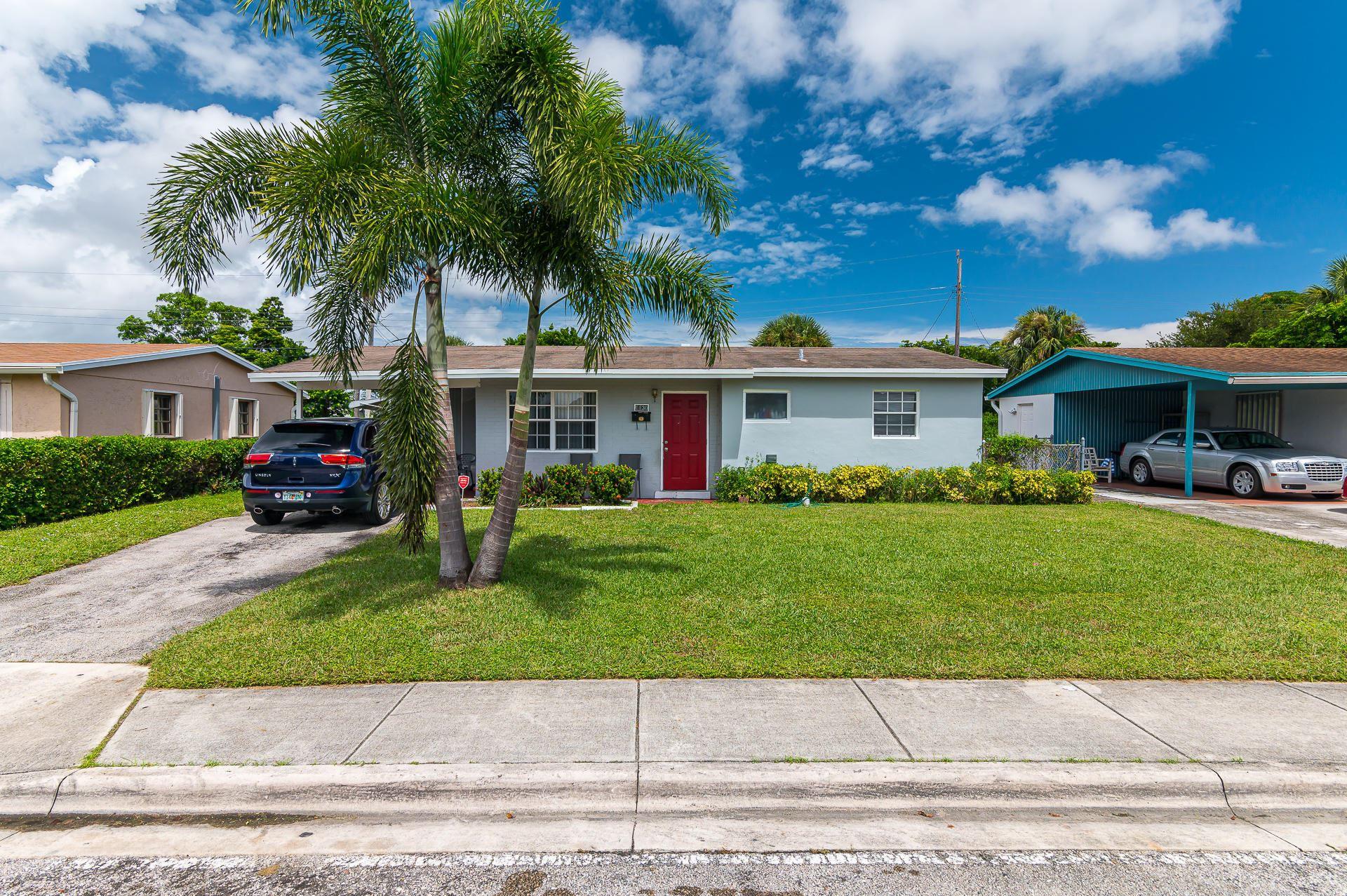 Photo of 1130 W 1st Street, Riviera Beach, FL 33404 (MLS # RX-10654166)