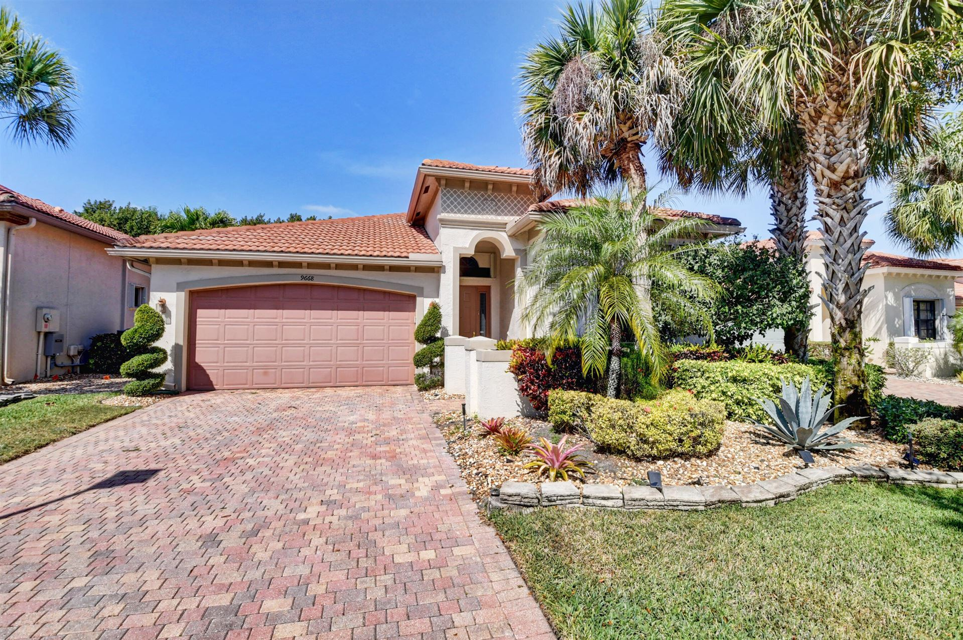 Photo of 9668 Isles Cay Drive, Delray Beach, FL 33446 (MLS # RX-10709166)