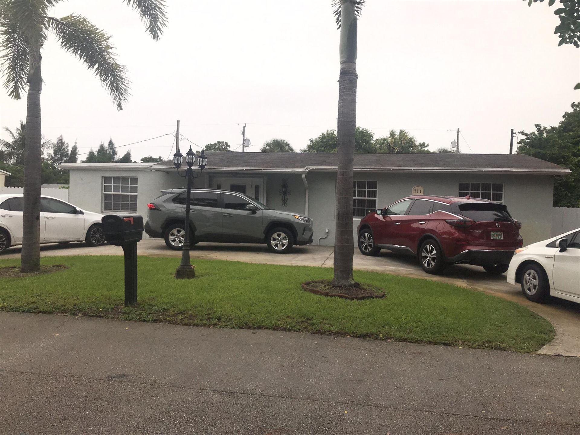 Photo of 771 Burch Drive, West Palm Beach, FL 33415 (MLS # RX-10736166)