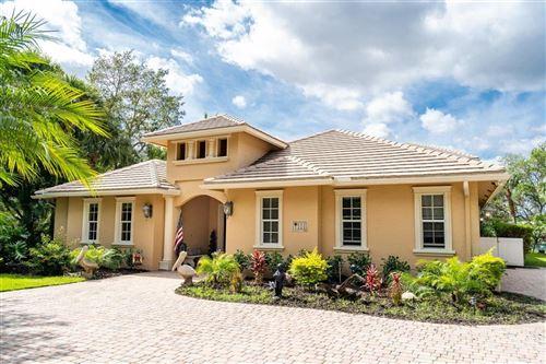 Photo of 111 NE Charleston Oaks Drive, Port Saint Lucie, FL 34983 (MLS # RX-10704176)