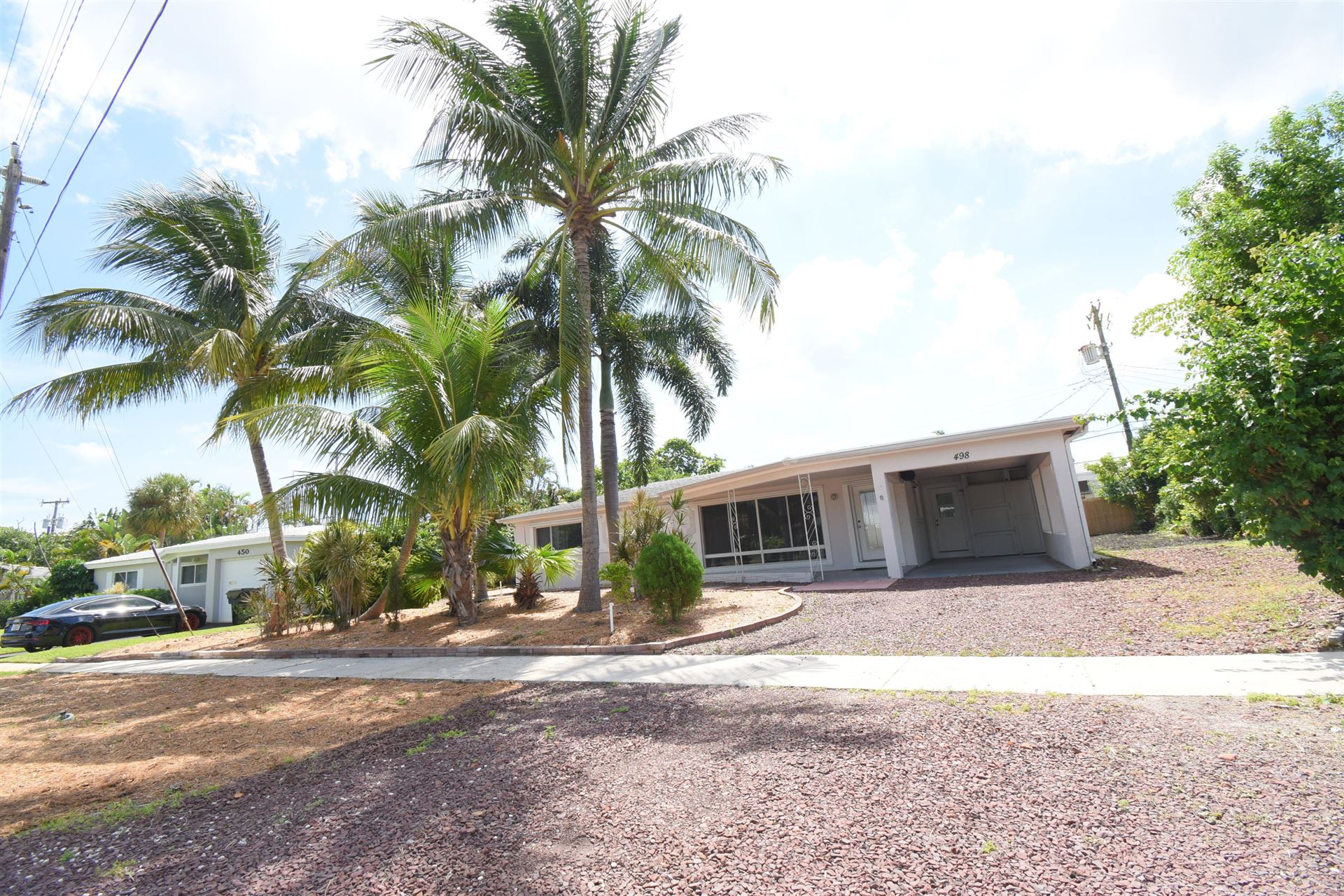 Photo of 498 NE 5th Circle, Boca Raton, FL 33431 (MLS # RX-10658176)