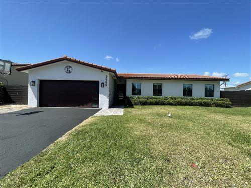 Photo of 7999 E Country Club Boulevard, Boca Raton, FL 33487 (MLS # RX-10707179)