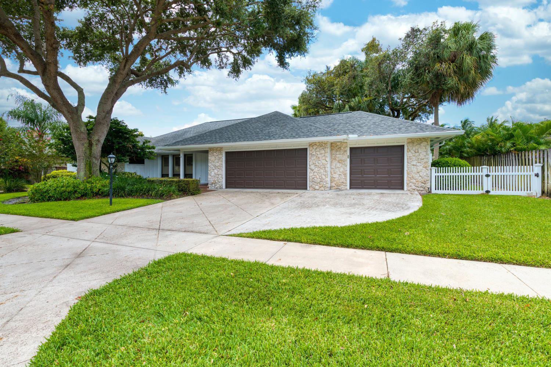 Photo of 2424 Palm Harbor Drive, Palm Beach Gardens, FL 33410 (MLS # RX-10657179)