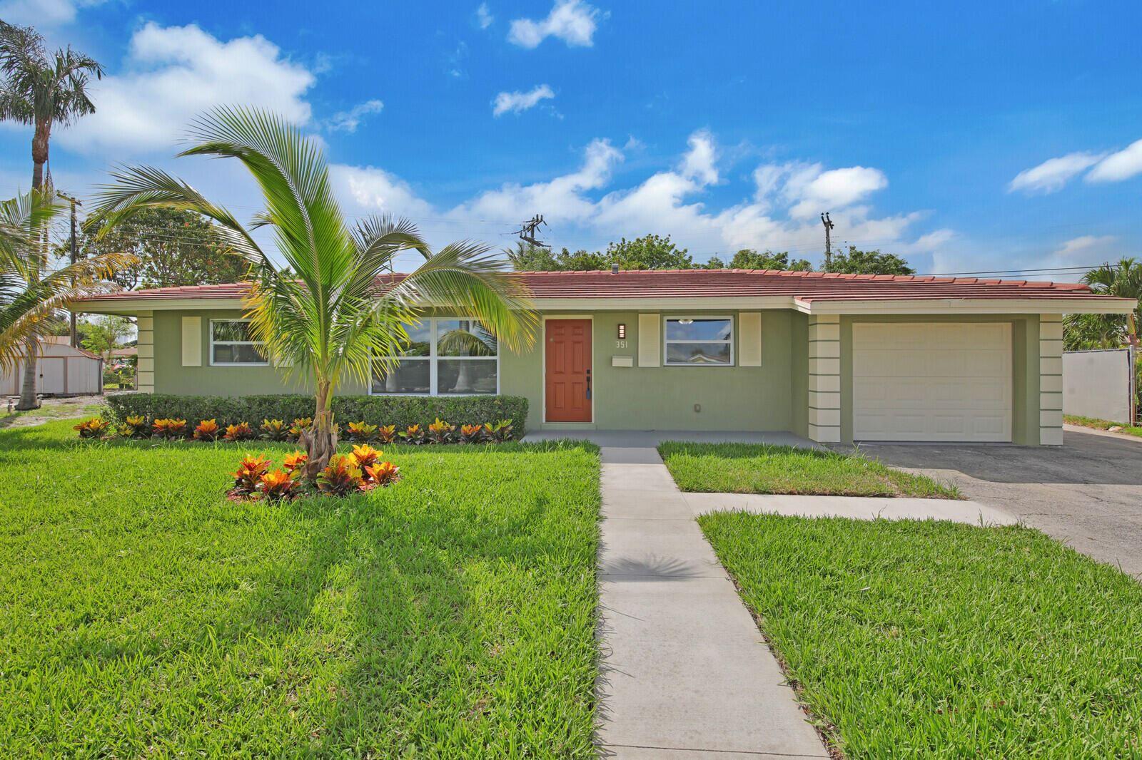 Photo of 351 W 30th Street, Riviera Beach, FL 33404 (MLS # RX-10714179)
