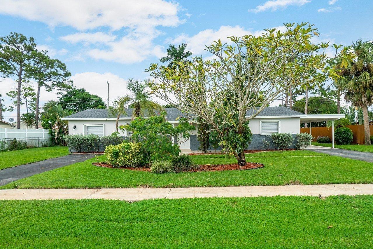 Photo of 1674 Maypop Road, West Palm Beach, FL 33415 (MLS # RX-10697185)