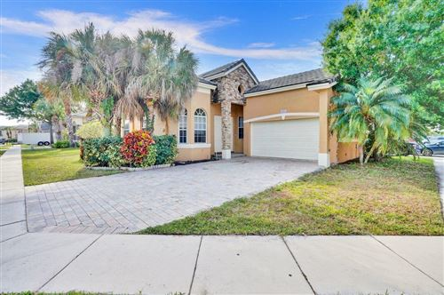 Photo of 6864 Spider Lily Lane, Lake Worth, FL 33462 (MLS # RX-10613189)
