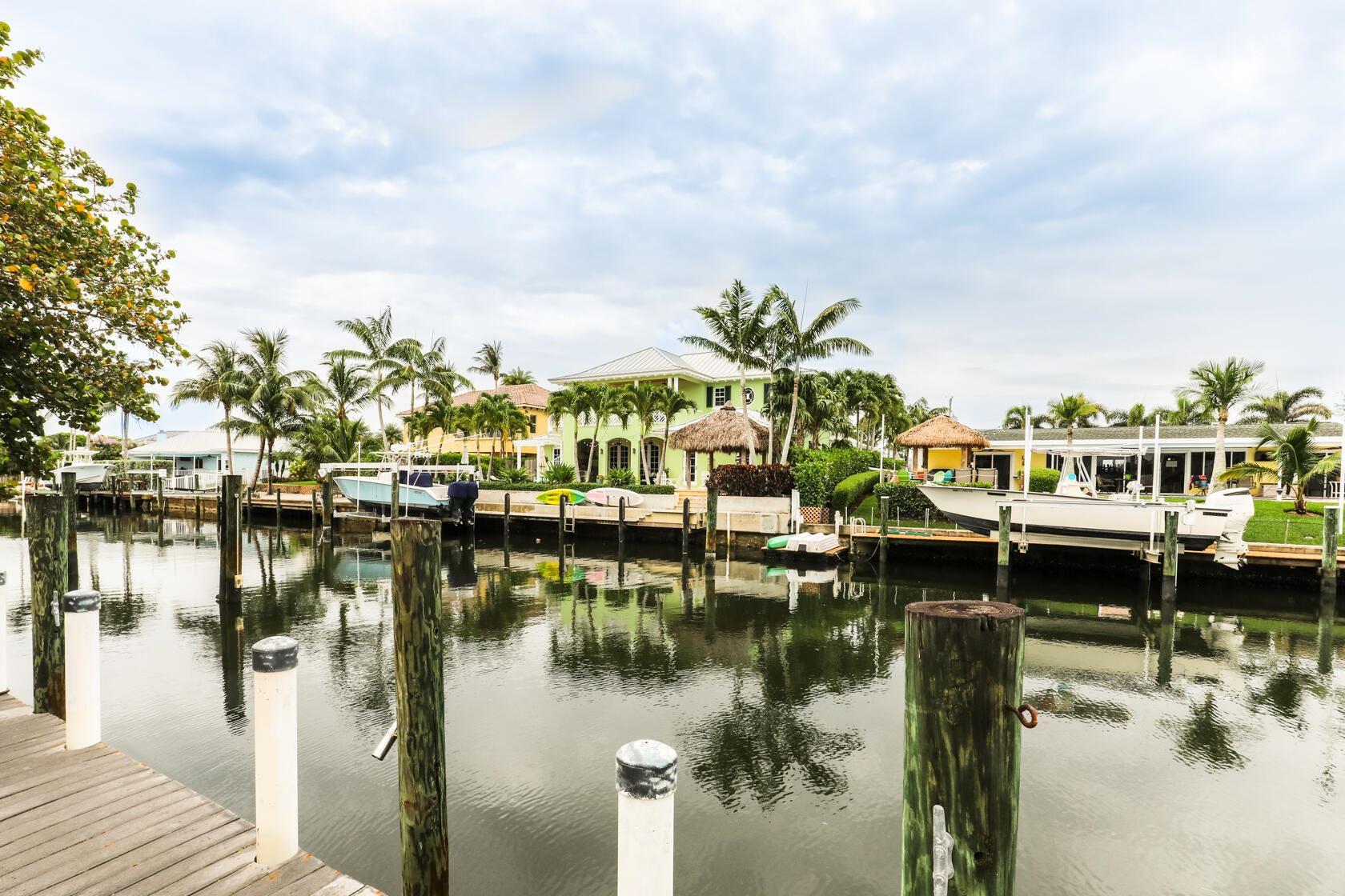 Photo of 716 Kittyhawk Way, North Palm Beach, FL 33408 (MLS # RX-10725193)
