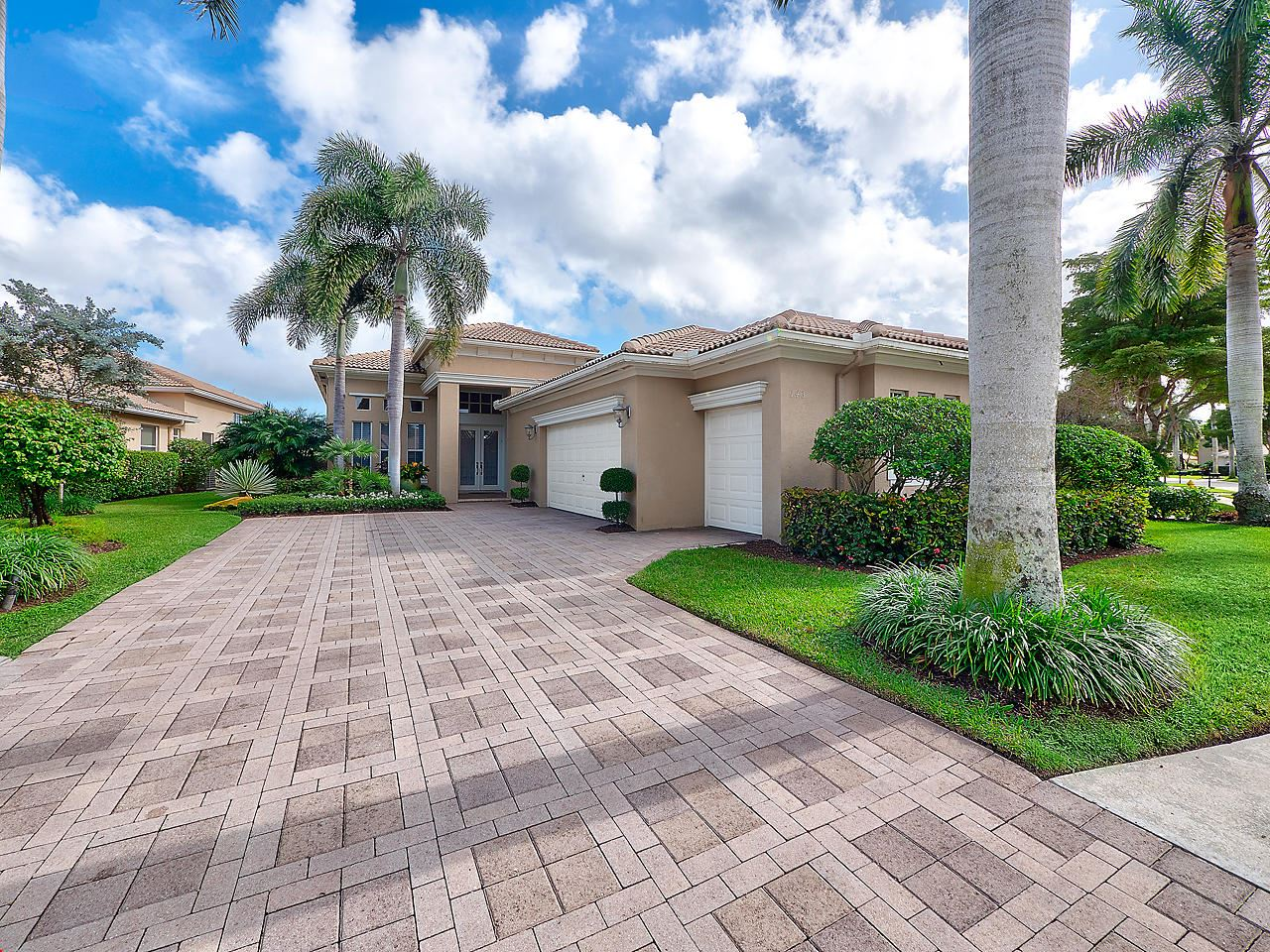 Photo of 143 Orchid Cay Drive, Palm Beach Gardens, FL 33418 (MLS # RX-10584194)