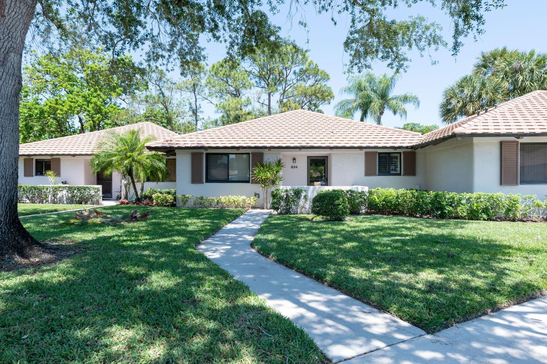 Photo of 834 Club Drive, Palm Beach Gardens, FL 33418 (MLS # RX-10709195)