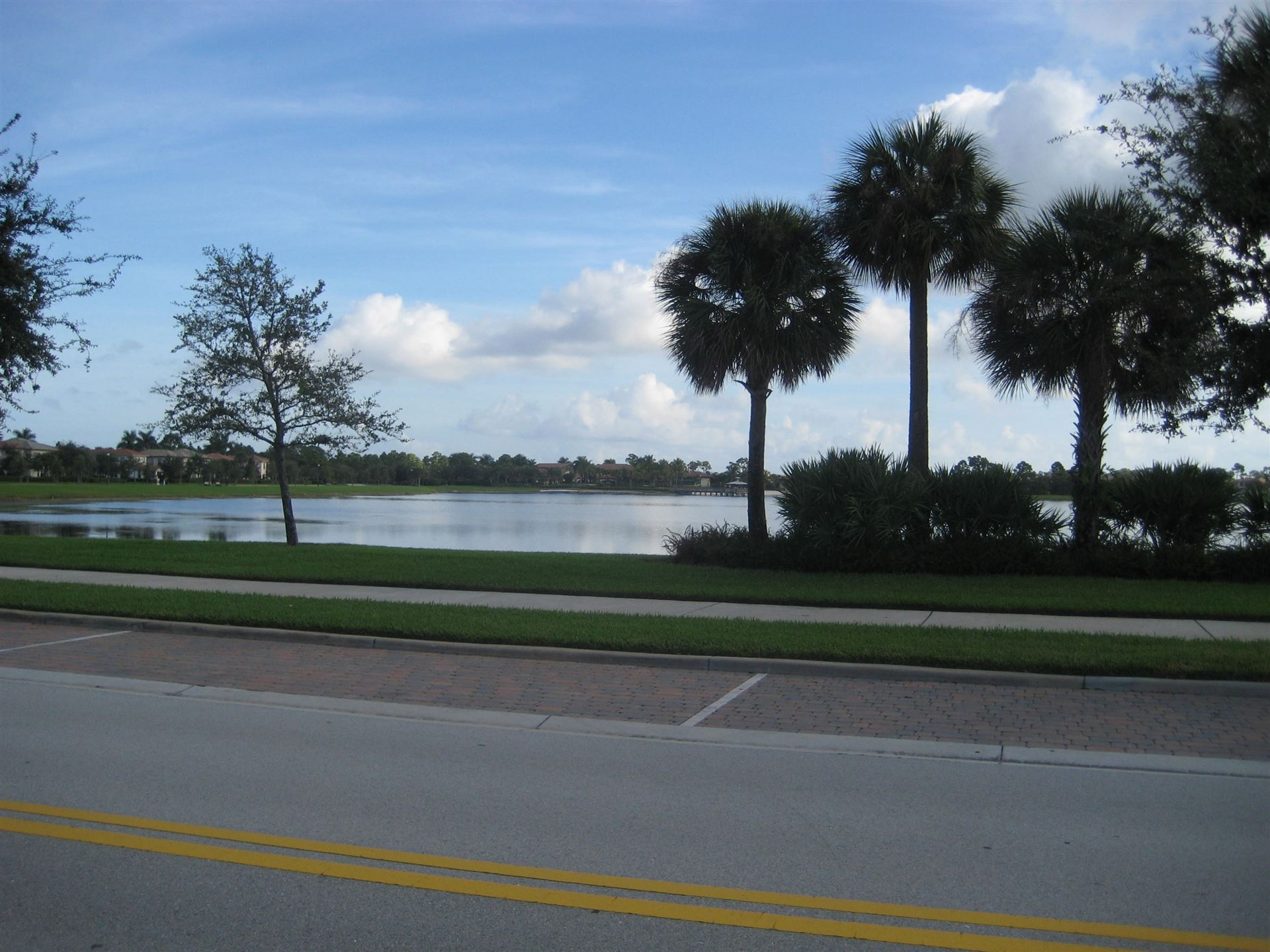 Photo of 213 Evergrene Parkway, Palm Beach Gardens, FL 33410 (MLS # RX-10671196)